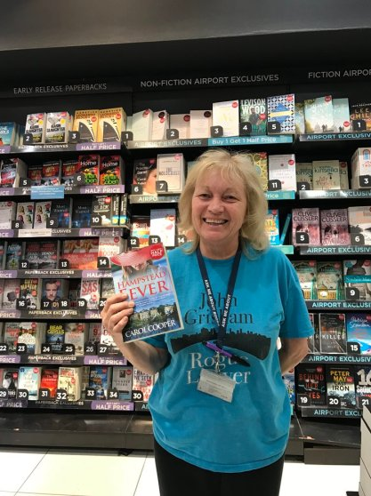Cathy from WH Smith at Gatwick Airport, with a copy of Hampstead Fever